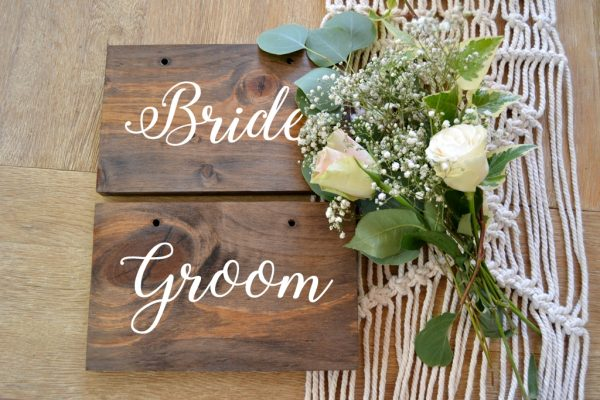 bride and groom chair sign